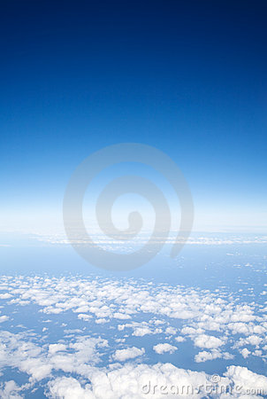Blue sky above light clouds,