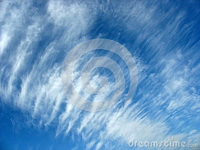 Blue sky background with fleecy clouds