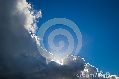 Blue sky behind dark clouds