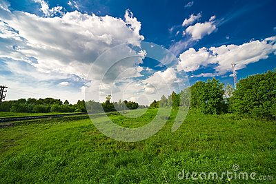 Blue sky with clouds and field
