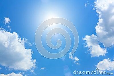 Blue Sky with Cumulus Clouds and Sun