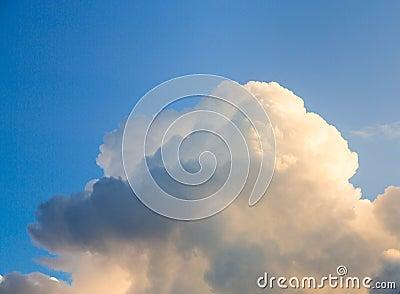 Blue Sky and dark puffy clouds