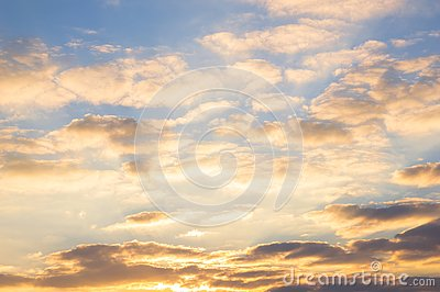 Blue sky and golden clouds at beautiful sunrise Stock Photo