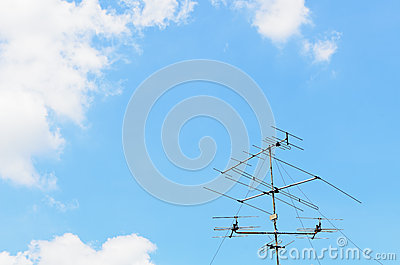 Blue sky with old tv antenna