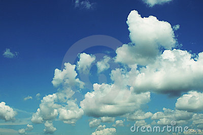Blue sky with puffy clouds