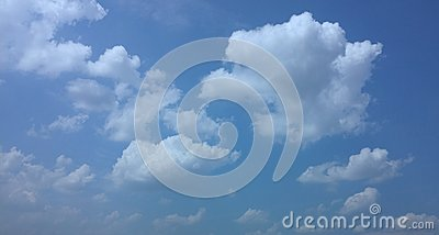 Blue sky, puffy clouds