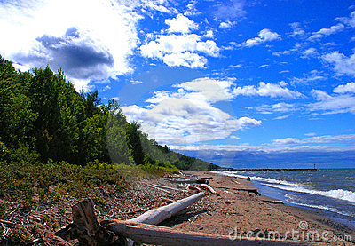 Blue sky and sloping beach