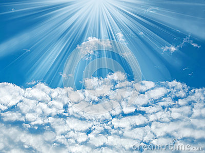 Blue sky with sun rays and clouds