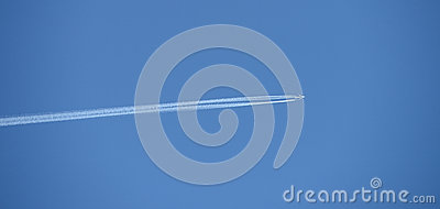 Blue sky with vapor trail