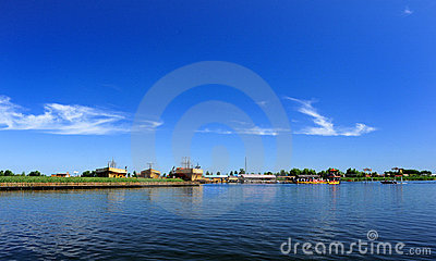 Blue sky, white clouds and lake