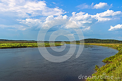 Blue sky and white clouds over the river Volga