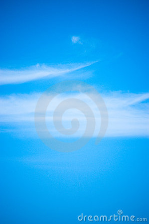 Blue sky & wispy cloud