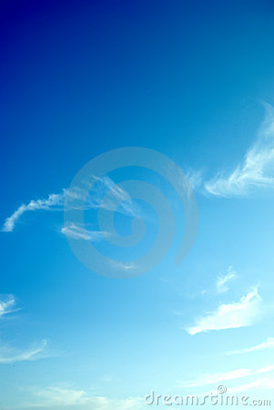 Blue sky and wispy clouds