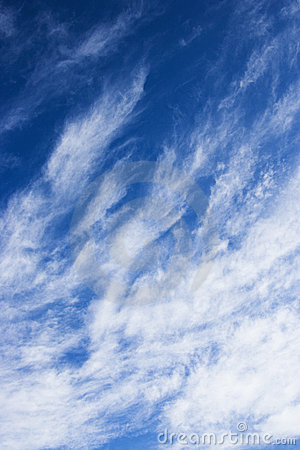 Blue sky with wispy clouds.
