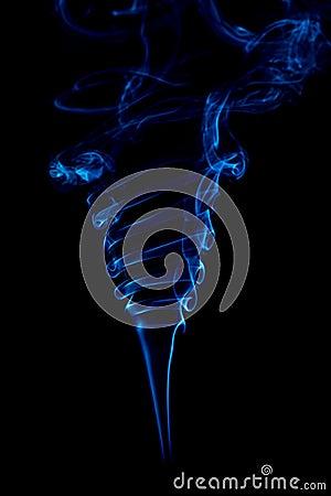 Blue smoke rings on black background