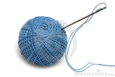 Blue spool of the threads with needle
