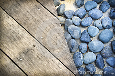 Blue stones wooden boards background