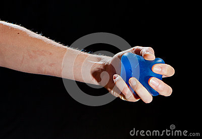 Blue stress ball in a female hand
