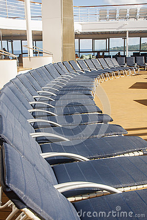 Blue Striped Chaise Lounges on a Ships Deck
