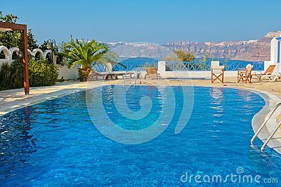 Blue swimming pool in Fira on island of Santorini