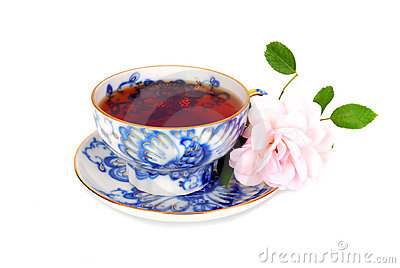 Blue tea cup and pink rose