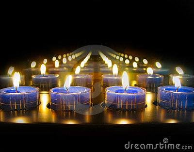 Blue tea lights burning