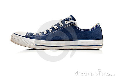 Blue tennis shoe on white