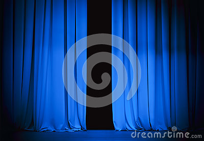 Blue theatre stage curtain slightly open