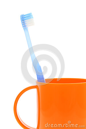 Blue toothbrush and cup