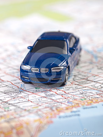 Blue toy car on a map