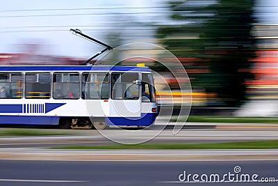 Blue tram rider fast