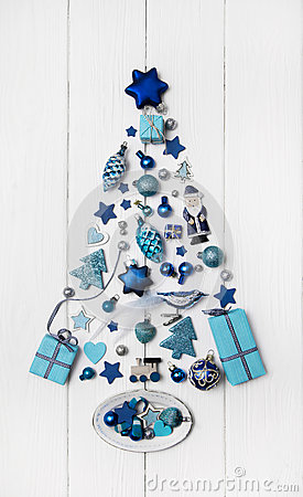Blue and turquoise christmas tree of small miniatures on white w Stock Photo
