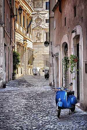 Free Blue Vespa In The Old Street Of Rome Royalty Free Stock Images - 114371139