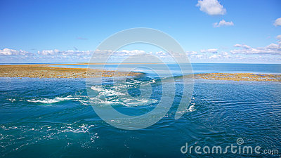 Blue water background with reef on low tide