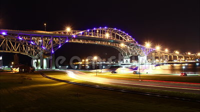 Blue Water Bridge Night Timelapse. The Blue Water Bridge connecting Port Huron, Michigan, USA with Sarnia, Ontario, Canada. The twin span bridge crosses the St stock footage