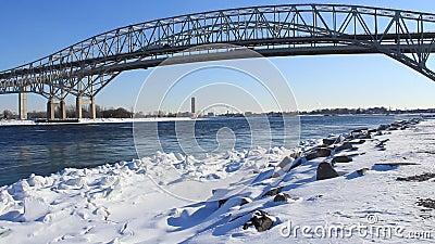 Blue Water Bridge Winter. The Blue Water Bridge connecting Port Huron, Michigan, USA with Sarnia, Ontario, Canada. The twin span bridge crosses the St. Clair stock footage