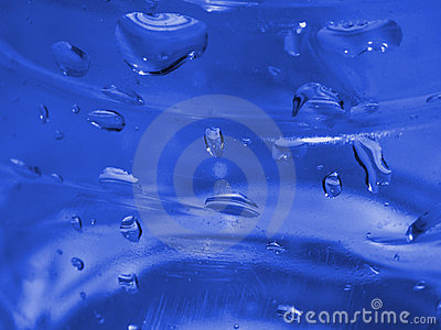 Blue Water Droplets on Plastic