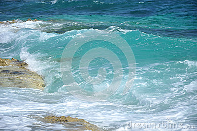 Blue waves crashing on a shoreline