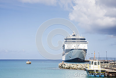 Blue and White Cruise Ship and Pilot Boat