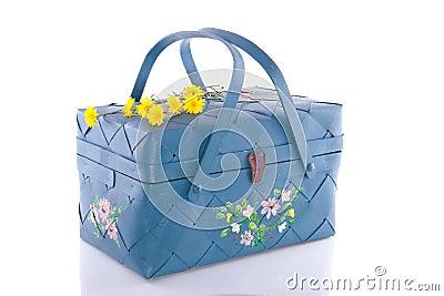 A blue wicker basket
