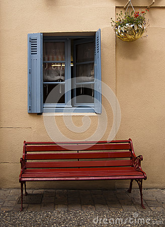 Blue window brown bench Brantome