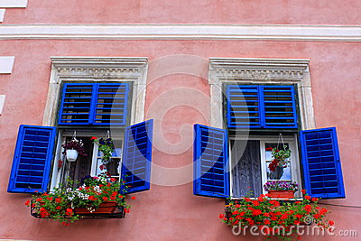 Blue windows with geraniums