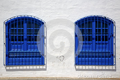 Blue wood   couple of window in a white wall arrecife lanzarote