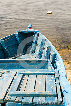 Blue wooden rowing boat.