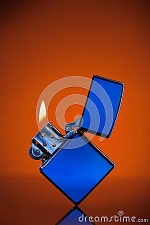 Free Blue Zippo Lighter On Orange Royalty Free Stock Photos - 21789148