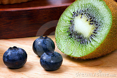 Blueberries and half of kiwi