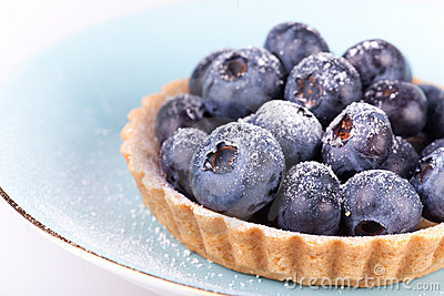Blueberries tart on the blue plate