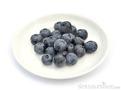 Blueberries on white dish