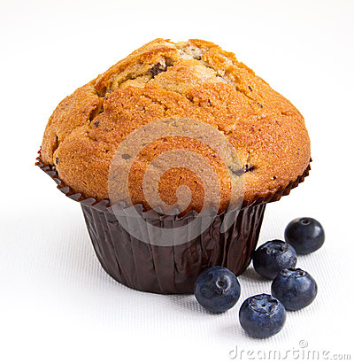 Blueberry muffin with fresh fruit on white