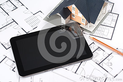 Blueprints, house and tablet